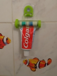 Rolling Toothpaste Tube Squeezer and Mirror Hanger Holder
