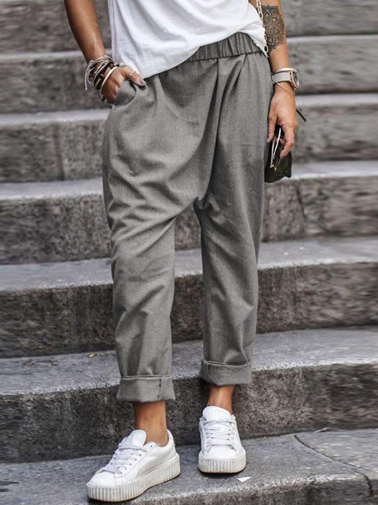 女性のカジュアルな弾性ウエストソリッドポケットパンツ